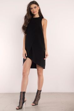 Designed by Tobi. The Magdalena Overlay Shift Dress features a slight mock neck and front overlay that peaks at the front. Shift body for an edgy silh - Fast & Free Shipping For Orders over $50 - Free Returns within 30 days!