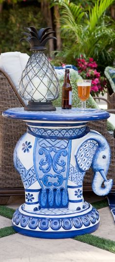 With its trunk pointed skyward, our Handpainted Elephant Side Table will bestow good luck and prosperity on your home. | Frontgate: Live Beautifully Outdoors