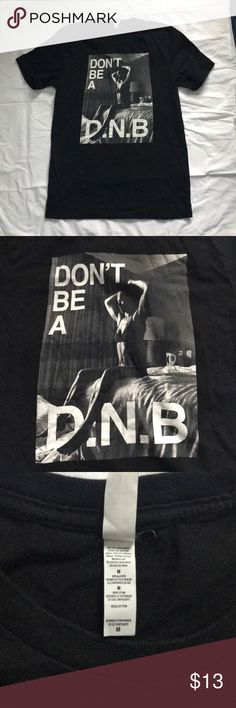 Ronda Rousey Don't Be A D.N.B Tee Great condition Ronda Rousey Do Nothing Bitch, no D.N.B. tee. Price negotiable, feel free to make an offer! Tops Tees - Short Sleeve