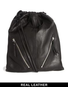 5c5aa20e35db ASOS Leather Drawstring Backpack with Double Zips at asos.com