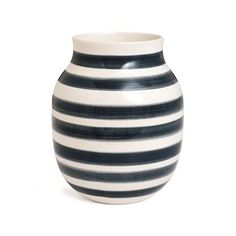 The classic Omaggio vase comes from the Danish brand Kähler and is designed by Ditte Reckweg and Jelena Schou Nordentoft. The vase is made of high quality ceramics and has a timeless striped pattern which is a hallmark for the Omaggio series. The striped vase fits most homes and environments and can be used for flowers or just as decoration. Combine it with other products from Kähler to create a trendy look in your home. Choose between different colors.