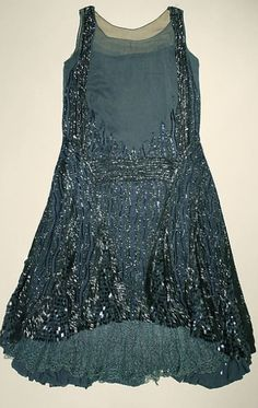 1927 couturier evening dress, with beaded embellishment create spectacular detail.