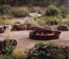 Informal seating areas. Bit too wild for your site? Like use of boulders and the rustic fire pit