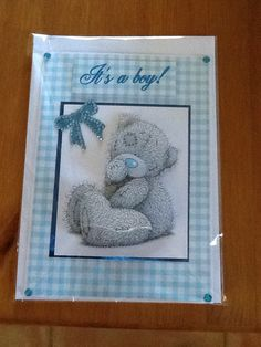 A5 card, on a blue gingham background with tatty Ted image mat and layered on blue mirror card, finished with a gem blue bow and gems in corners, comes with insert and envelope.
