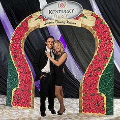 Our Kentucky Derby Rose Horseshoe Arch features horseshoe arch with a design of red roses covering it with and a personalized derby sign on the top.
