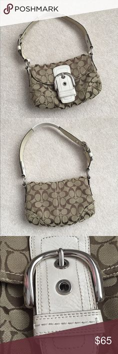 Coach Shoulder Purse My sister Bought it in Las Vegas.  Has been used but in amazing condition. The strap is not damaged or torn. Has a magnetic belt clasp that's not tarnished or damaged. It's the classic coach print with white leather accents. It's very clean on the outside. The inside has only a red mark on the leather tag and small marks at the bottom of the pocket that can be easily cleaned. You can't really tell in the photos. Great deal for a shoulder bag in this condition. Super…