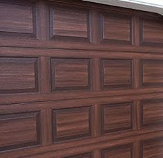 Faux garage doors make a metal garage door look like wood would you can paint a steel garage door to look like wood solutioingenieria Images
