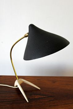 found this real cool lamp made by Caltrop Stand on http://adoremodern.com/