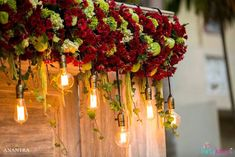 Gorgeous flowers with lights from a Rustic Vintage 21st birthday Party at Kara's Party Ideas. See the pics at karaspartyideas.com!