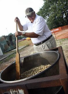 Charles Haggard, the mayor of Pelion, stirs a pot of boiled peanuts as he has done every year since the South Carolina Peanut Party's inception 31 years ago. He estimates 50-60 bushels of peanuts will be boiled for the event. The 31st annual South Carolina Peanut Party continues Saturday 8 a.m. to 11 p.m.The event features a parade, dog show (dog and owner look-a-like and best dressed dog contest), a peanut butter and jelly sandwich eating contest, car show, peanutty recipe contest and local…
