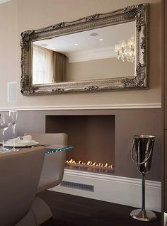 .mirror over the fireplace colored to match