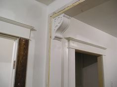 Scroll work corbels with recessed center, flush bottom bead