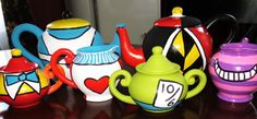 Unfinished ceramic tea sets from Michael's, painted like the characters for an Alice in Wonderland birthday party