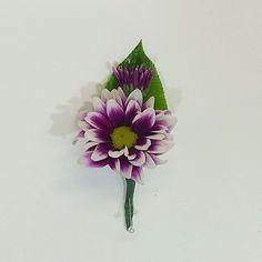 Purple daisy boutonnière.