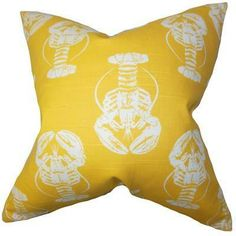 This bright lobster pillow is fun and cozy.
