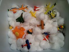 Here is our Airplane Sensory Bin. I used Cotton Balls, A toob of planes, and some toy planes we had around the house. Airplane Activities, Pre K Activities, Sensory Activities, Sensory Tubs, Sensory Play, Preschool Crafts, Crafts For Kids, Transportation Activities, Messy Play
