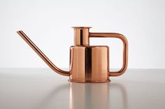 The x3 watering can, designed by Paul Loebach, is made using a single metal tube, bent three times (X-3), to create both the handle and the pour spout. Available in Solid Copper, Brass, or Painted Stainless Steel. Produced by Kontextür.