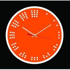 """L'horloge """"Minimaliste n°2"""" est une horloge murale avec un cadran simple et sobre, chaque chiffre est remplacé par une série de petits cercles assimilée numériquement au chiffre qu'il représente. Cette horloge fabriquée en France plus précisément à Besançon est équipée d'un mouvement à quartz précis ultra silencieux, de deux aiguilles, d'une trotteuse et d'un crochet de suspension. Plusieurs couleurs disponibles."""