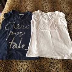 2 Aeropostale tee shirts The blue one has Aeropostale written on it, with silver sequins and the white one has sequins on the pocket! Both super cute on! Aeropostale Tops Tees - Short Sleeve