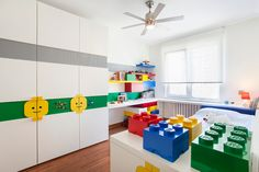 Having a Lego-inspired bedroom theme can leave a lot up to the imagination without the room being too immature. There are fun ways to bring in the Lego Lego Bedroom, Home Decor Bedroom, Girls Bedroom, Lego Room Decor, Boy Room, Kids Room, Casa Lego, Lego Display, Striped Walls