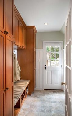 Mud room ideas.  Bench seating with cabinetry or cubbies.