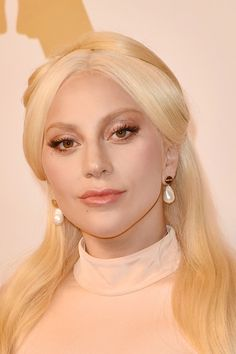 Lady Gaga Metallic Eyeshadow - Lady Gaga played up her eyes with a heavy application of gold shadow for the Academy Awards nominee luncheon.