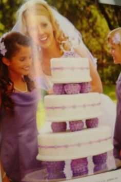White and purple fondant cake with flower details  Super for a wedding