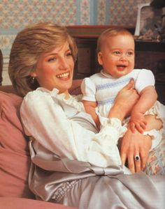 February A baby Prince William with his mother, The Princess of Wales, at home in Kensington Palace, London. Princess Diana wearing a silver pinafore style dress with a white blouse underneath. Princess Diana and Prince William both looking gorgeous. Princesa Charlotte, Princesa Diana, Princess Diana Family, Prince And Princess, Princess Of Wales, Prince Harry, Baby Princess, Lady Diana Spencer, Diana Son