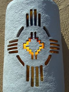 Zia Porch Light with NM State Symbol...beautifully designed to complement a Southwestern adobe stucco wall.