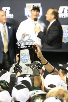 The Baylor Bears celebrate with the 2015 Russell Athletic Bowl trophy after their 49-38 win over the North Carolina Tar Heels. #SicEm