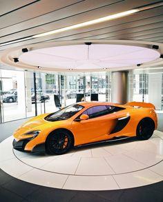 McLaren 675LT painted in McLaren Orange w/ satin carbon fiber Photo taken by: @c.ll.m on Instagram