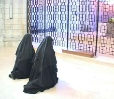 Benedictine nuns two before the altar to the Divine Office