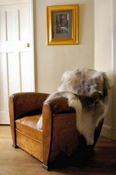 Gorgeous Reindeer hide draped over this vintage leather tub chair