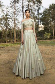 GUL- Mint green raw silk full embroidered tasseled blouse paired with scattered buta heavy embroidered lehenga. CARE: Dry Clean Only Indian Wedding Outfits, Pakistani Outfits, Indian Outfits, Indian Clothes, Green Lehenga, Lehenga Skirt, Lehenga Blouse, Lehenga Choli, Indian Designer Outfits