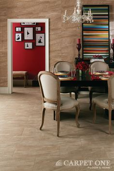 Tile is great for a dining space. Food spills and stains just wipe right off!  Daltile available at Carpet One Floor & Home