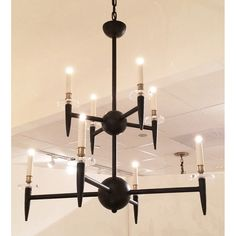 2207 Riley Chandelier Dimensions: 	38″dia x 39″h Finish Shown:Old Iron/Brass/Lucite Lamping: 8 candelabra