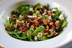 Baby Arugala Salad with walnuts, dried cranberries and feta . Includes great dressing recipe