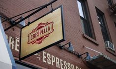 """Crespella is an Italian crêpe and espresso bar located in Park Slope, Brooklyn."" -- simple painted font on faux brick sorta old school then another sign mounted out from wall hovering above sidewalk."