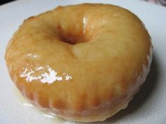 krispy creme doughnuts w/ glaze and chocolate glaze..