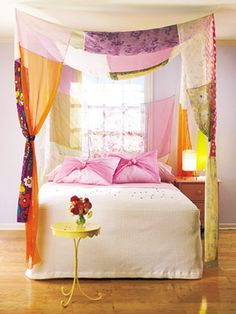 Curtain Call     Create a simple canopy without a four-poster. Measure a piece of fabric to suspend over the length and width of the bed. Sew (or use fusible web) side panels along the corners of the fabric. Suspend over the corners of the bed with hooks screwed into the ceiling.