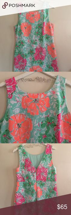 Lilly Pulitzer size L floral dress This beautiful Lilly dress is in mint condition! It has only been worn once! It is a beautiful teal dress with peach and pink flowers. Beautiful pattern and perfect for the spring and summer! Lilly Pulitzer Dresses Midi