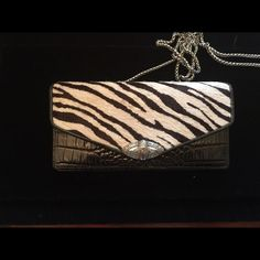 Brighton wallet/purse Brighton zebra print wallet with silver strap to carry as a purse also. Loads of compartments for you money, credit cards, check book etc Brighton Bags Wallets