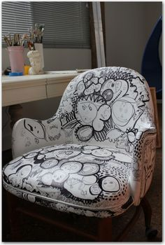 this was an old vinyl office chair she primed with latex white and then had kids and friends draw faces...with SHARPIE...then she is filling it in with doodles