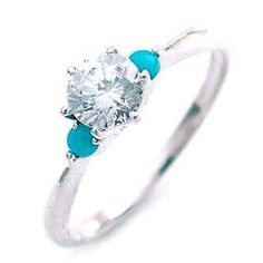 Turquoise:) my favorite.  Interesting take on an engagement ring! Def unique and beautiful!