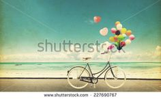Paper Card of bicycle vintage with heart balloon on beach blue sky concept of love in summer and wedding honeymoon - Shutterstock Premier
