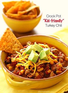 "Here's a healthy crock pot ""kid-friendly"" turkey chili recipe made with ground turkey, corn, bell pepper, tomatoes and spices for the perfect, back to school lunch for your kids."