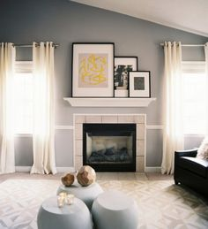 how to display artwork above fireplace with vaulted or cathedral ceiling. Ideas for decor as well