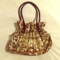 "Leopard Print   shoulder bag Beautiful hang bag /Colors/ Brown Beige Gold / Material Gold metal  Vynol/ Size L15"" W3.4""  H 9.5"". New never used. Buy now or best offer. Kathy Van Zeeland Bags Totes"