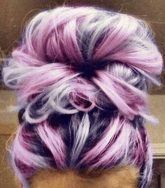 Unique hair color with messy bun.