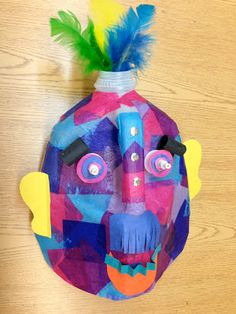 Recycled materials make for exciting art possibilities! Fifth graders used plastic milk jugs to create masks inspired by those o...